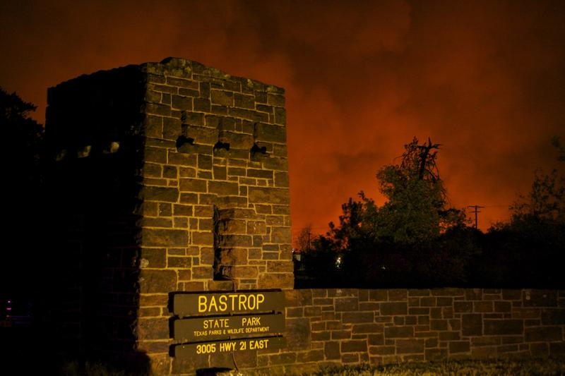 The entrance to Bastrop State Park at night