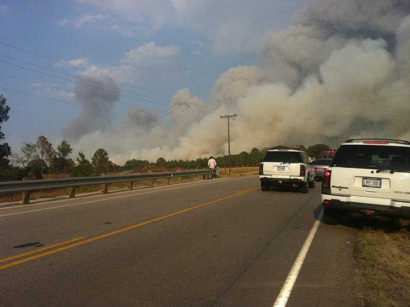 Smoke can be seen for miles as fire sweeps through Bastrop County. Photo by Matt Largey for KUT News.