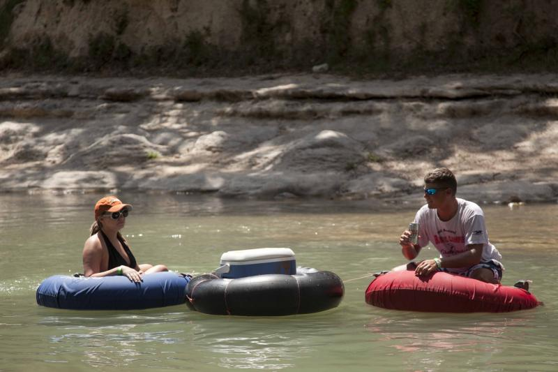 Tubers drifting down the drought-depleted Guadalupe River.