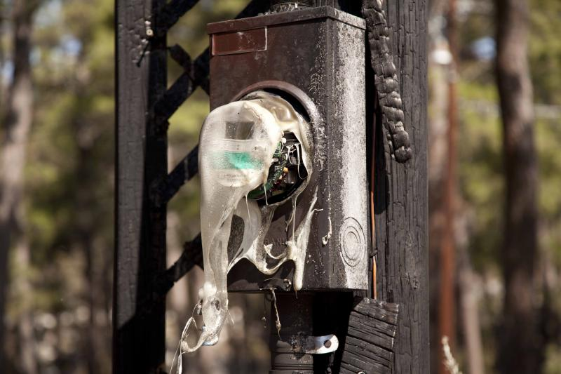 An electric meter melted by the flames that ravaged Bastrop Texas in early September.