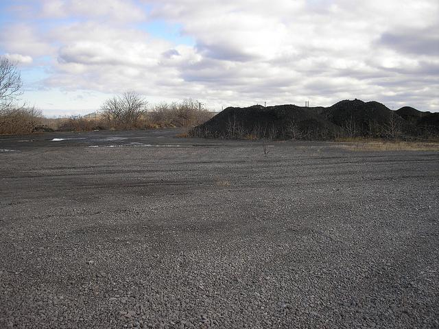 "The White Stallion plant would burn coal and petroleum coke, known as ""pet coke"" like this. This is a former RTI Coke Plant Parcel in Ohio."