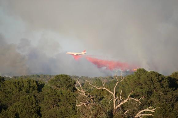 A tanker plane drops fire retardant on the Old Potato fire in Bastrop, that began October 4, 2011.