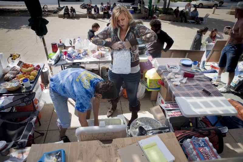 Members of Occupy Austin set up a food table on Friday.