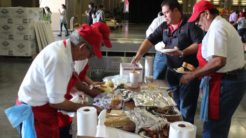 H-E-B employees prepare approximately 13,000 plates for tonight's Feast of Sharing Event.