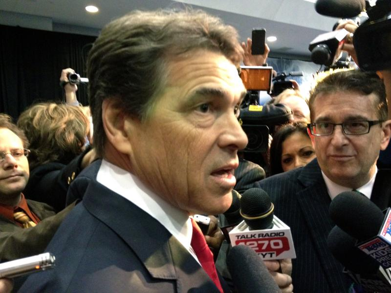 Rick Perry meets with reporters after Wednesday's Michigan debate. He joins his GOP presidential rivals on stage in South Carolina tonight.
