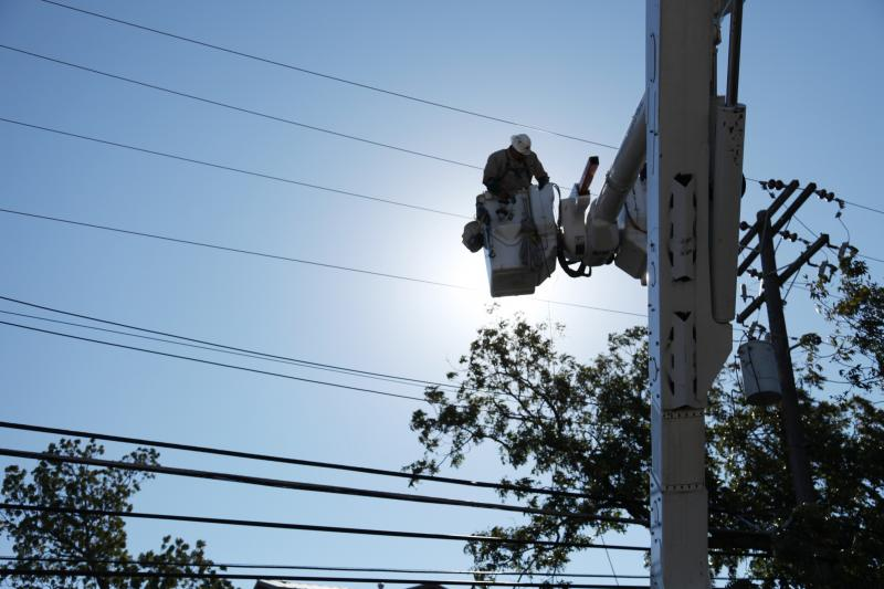An Austin Energy worker conducts repairs on a power line. The public utility is proposing a 12.5 percent rate hike.