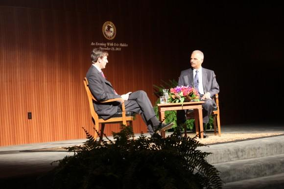 U.S. Attorney General Eric Holder (right) with LBJ Presidential Library and Museum director Mark Updegrove on December 13, 2011. Holder vowed to fight the redistricting maps passed by the Texas Legislature.