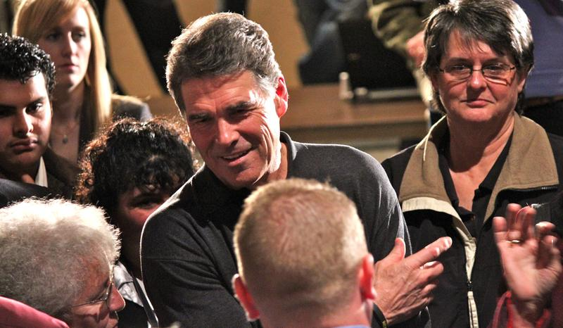 Rick Perry talks with voters in Marshalltown, Iowa
