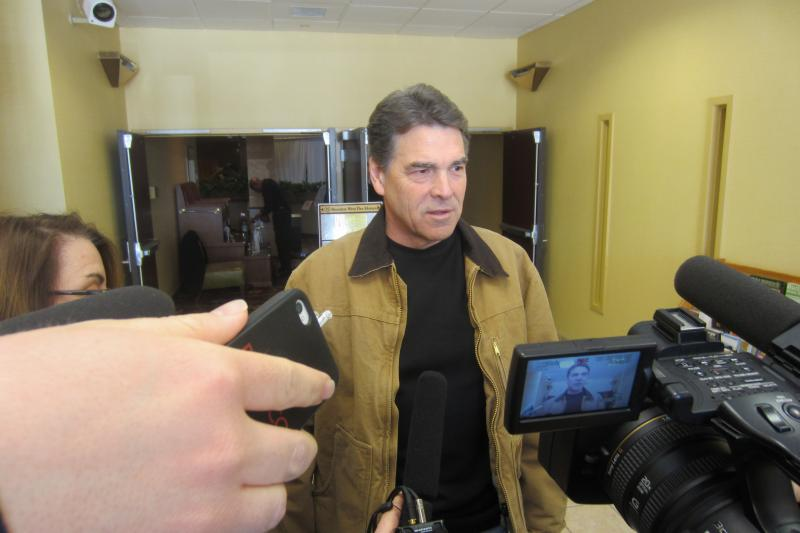 Texas Governor Rick Perry speaking to reporters the morning after the 2012 Iowa Caucus.