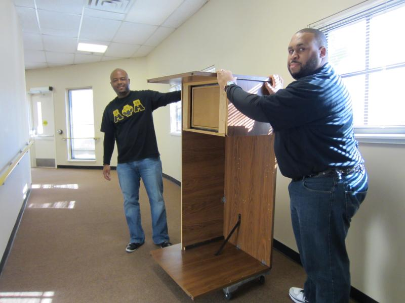 Al Lemon (left) and Bruce Johnson volunteer to move furniture at the Austin Groups for the Elderly as part of the annual MLK Day of Service event.
