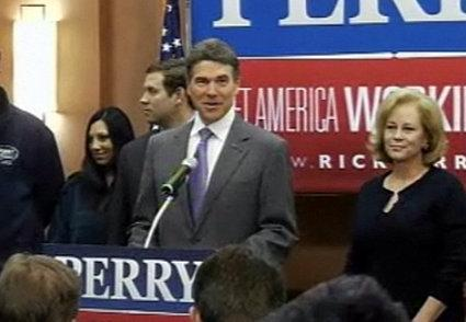 Gov. Rick Perry, flanked by wife Anita, at the announcement this morning.