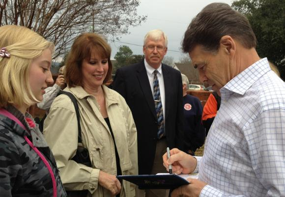Texas Governor Rick Perry signs autographs in South Carolina ahead of next Saturday's GOP presidential primary. Photo by Jay Root of The Texas Tribune.