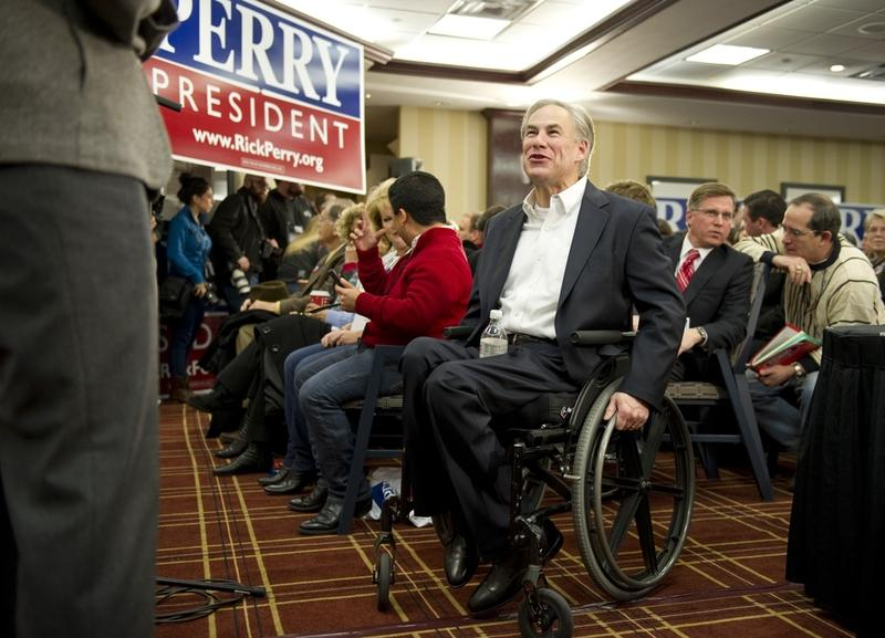 "Texas Attorney General Greg Abbott greets members of the Texas ""strike force"" in Iowa to support Governor Rick Perry on January 3, 2012."