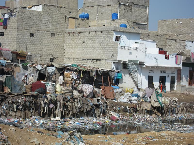 A garbage dump in southern Karachi, Pakistan. Some children who grow up here attend an NGO school nearby.