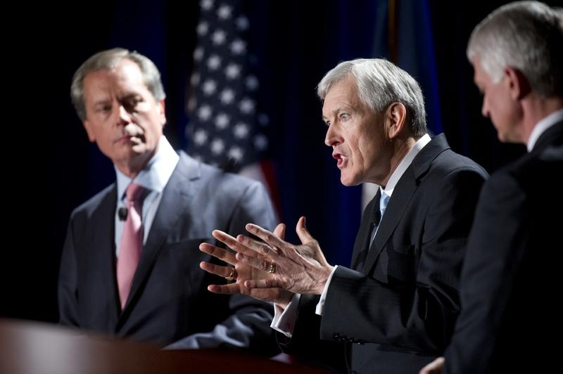 Former Dallas mayor and Republican U.S. Senate candidate Tom Leppert makes a point while David Dewhurst, left, and Glenn Addision, right, listen during a TPPF candidate debate on January 12, 2012.