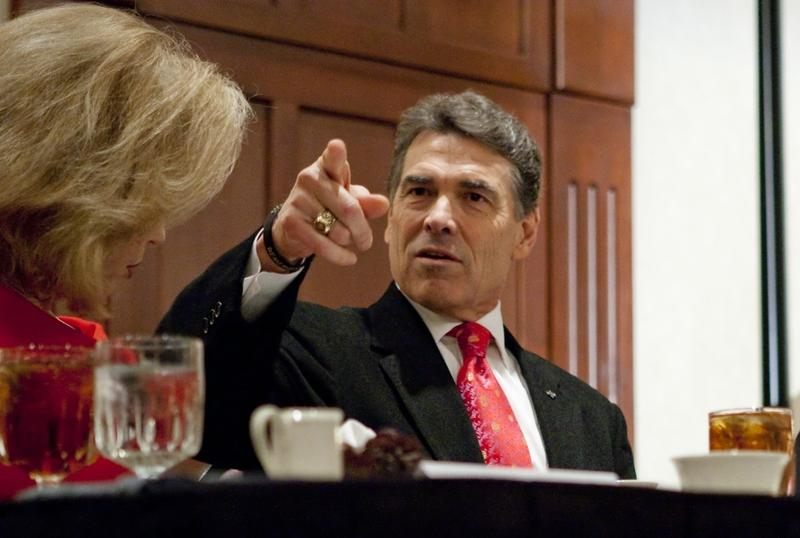 Gov. Rick Perry with wife Anita at Williamson County Republican dinner in Round Rock, his first public speech since leaving the presidential race.