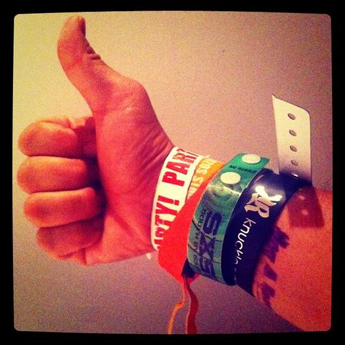 A 2011 SXSW attendee pleased with his wristband collection. Wristbands for SXSW Music 2012 go on sale this morning.