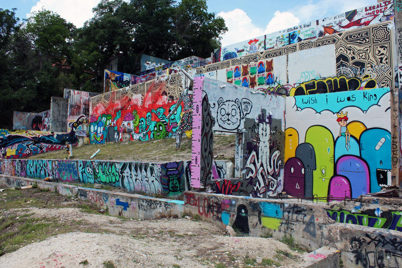 "The ""graffiti wall"" at 11th and Baylor streets is renowned for its ever-changing walls."