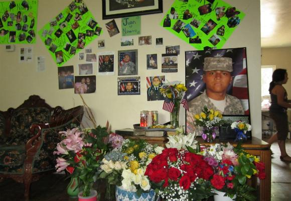 Sgt. Juan Navarro's friends and family left mementos at his home after he was killed in Afghanistan on July 7.