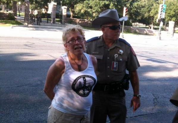"One of the ""chalkers"" arrested yesterday. Similar chalking events were held by Occupy organizations across the county."