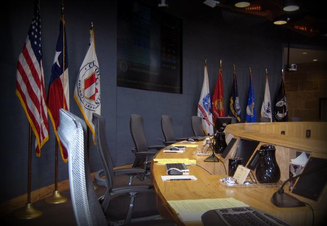 Under two proposals reorganizing city government, the council dais would grow from seven to 11 seats.