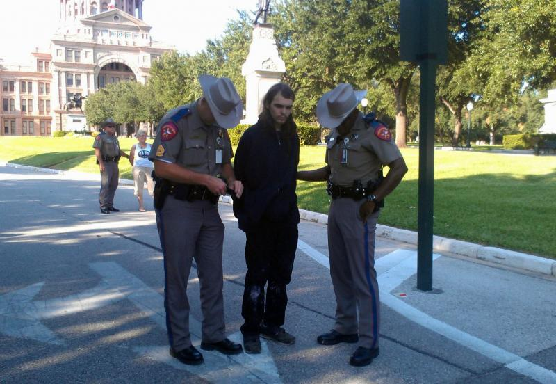 Another arrest at yesterday's chalking event. The individuals were arrested across the street from the Capitol grounds, then taken back to the Capitol for frisking and processing,