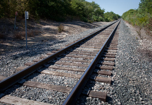 Cap Metro plans to install flashing warning lights at six private rail crossings.