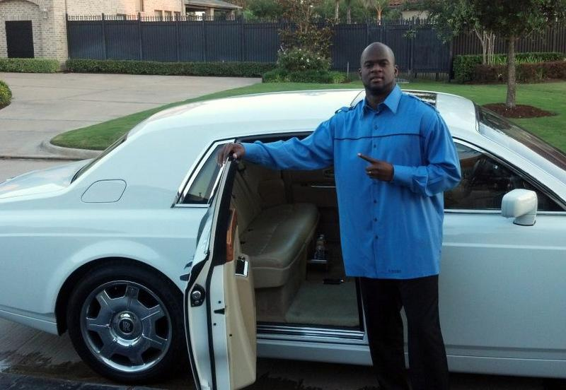 Vince Young posing with a Rolls-Royce Phantom in May. Young has taken to Twitter to dispute reports he's in financial trouble.