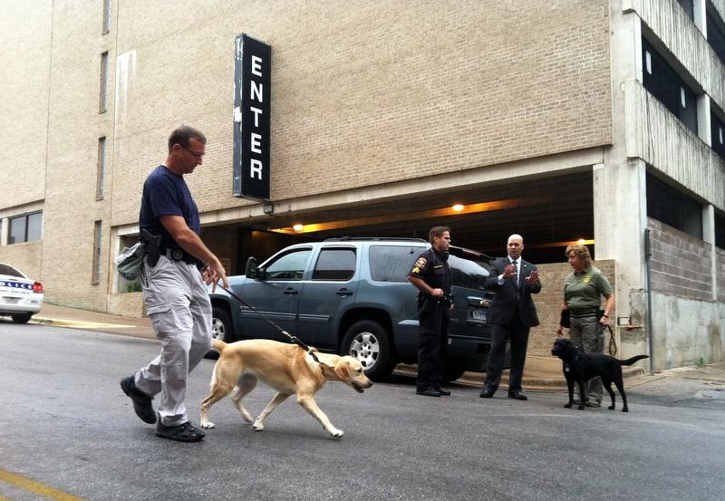 Law enforcement officials - and their dogs - patrolled near the Dobie Mall earlier today.