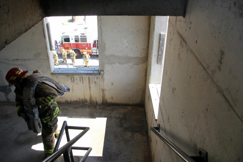 A firefighter makes his way down the Austin Fire Department's Pleasant Valley training tower.