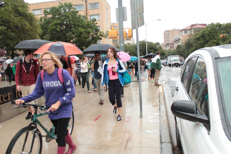 Students and faculty evacuate the UT campus Friday morning.