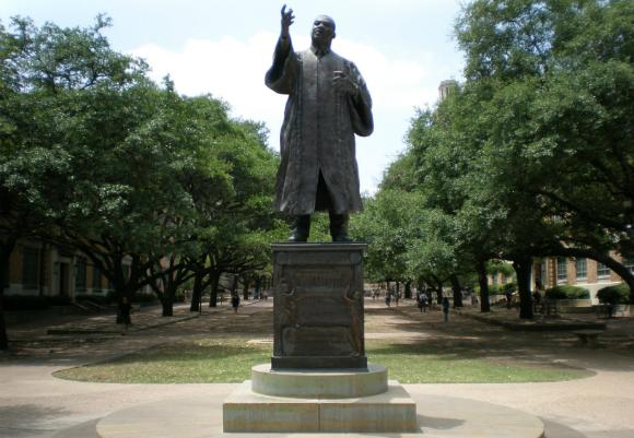Students marched to the MLK statue on campus to protest bleach balloon attacks in the West Campus.
