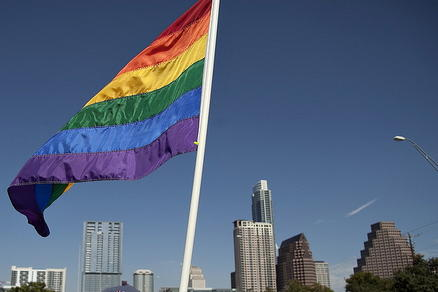 A rainbow flag flies high at Austin Pride, but a report says transgendered Texans are fighting high rates of discrimination.
