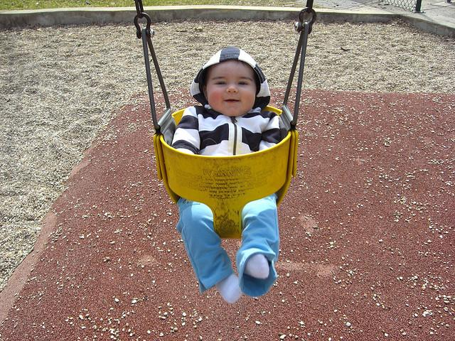 A young parks enthusiast enjoys a swing at Zilker Park. Zilker is among the metropolitan parks that would receive funding from Prop 14.