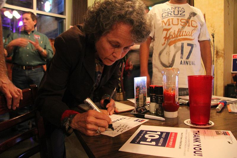 Linda Curtis signs a thank you card to the people who helped put Prop 3 on the ballot