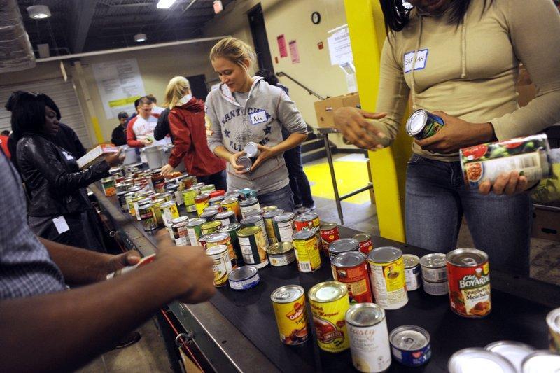 Volunteers sort donations to the Capital Area Food Bank in 2011.