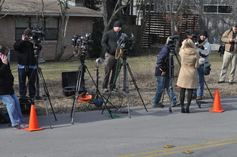 Hoping to see Oprah Winfrey, the media parked and set up cameras outside of Lance Armstrong's home in Austin.