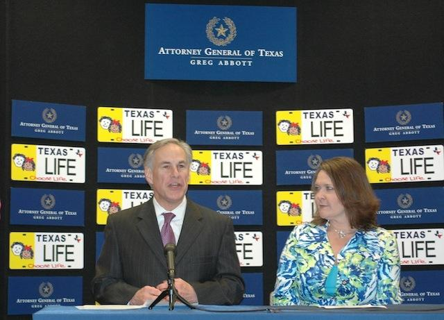 "Texas Attorney General Greg Abbott and ""Choose Life"" Advisory Committee member Julie Stobbe at a Friday press conference."