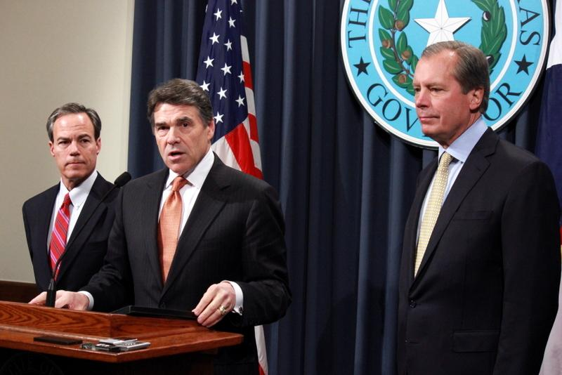 Joe Straus, Rick Perry and David Dewhurst talk to reporters Wednesday.