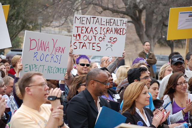 Texans gather outside the Capitol for a rally in support of mental health funding.