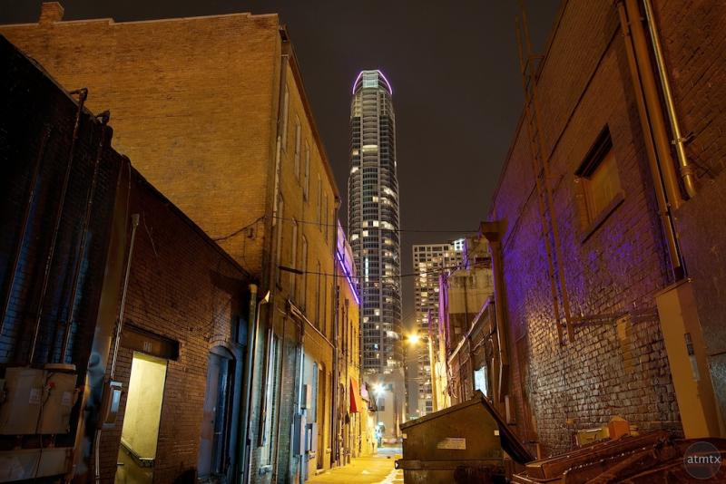 Old and the new: The Austonian towers over an alleyway in downtown Austin.