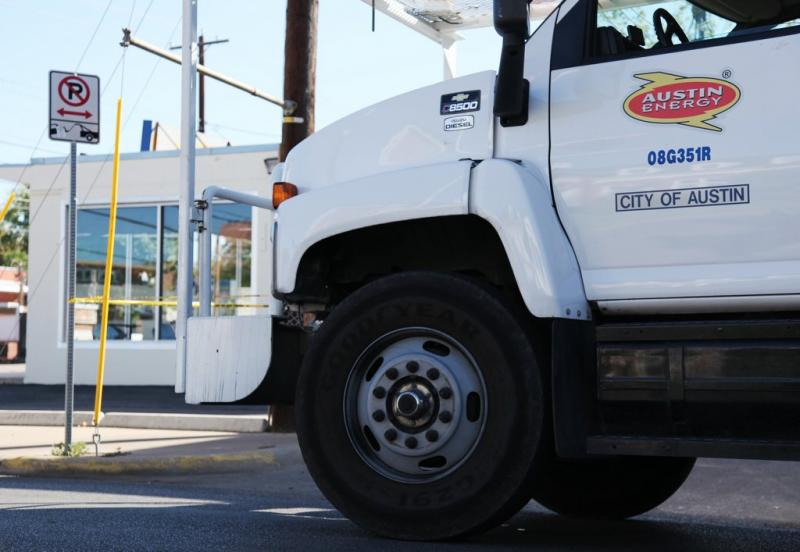 An Austin Energy truck makes repairs in the West Campus. The city council is debating whether an independent board should oversee the utility.