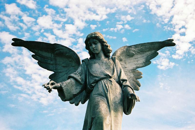 A graveyard angel keeps watch over Oakwood Cemetary in East Austin.