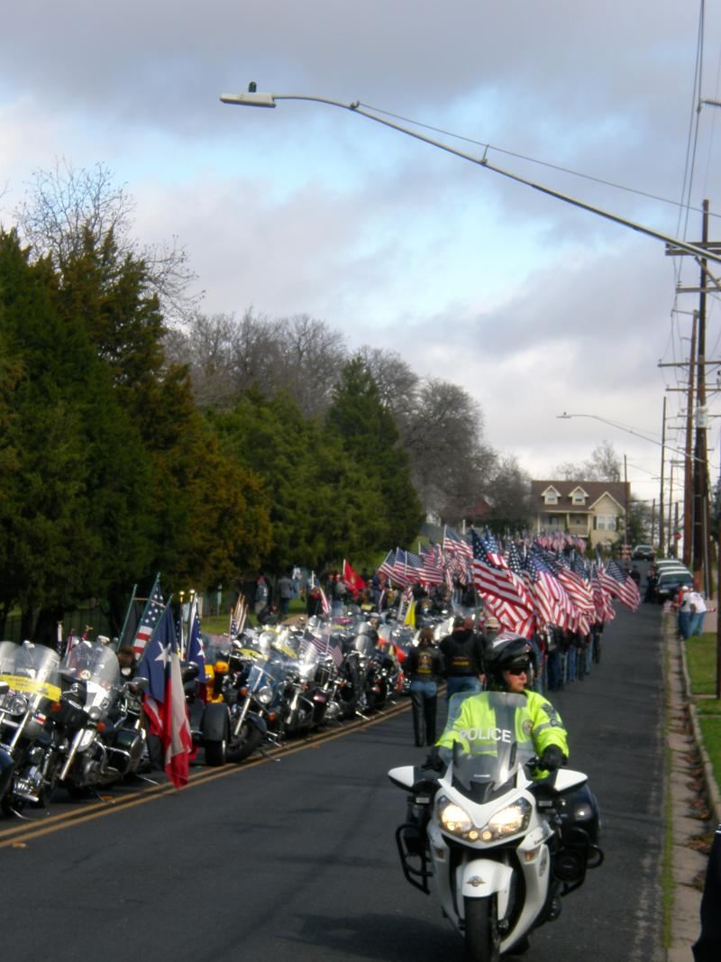Patriot Guards arrive from the procession for Chris Kyle's funeral at the Texas State Cemetery.