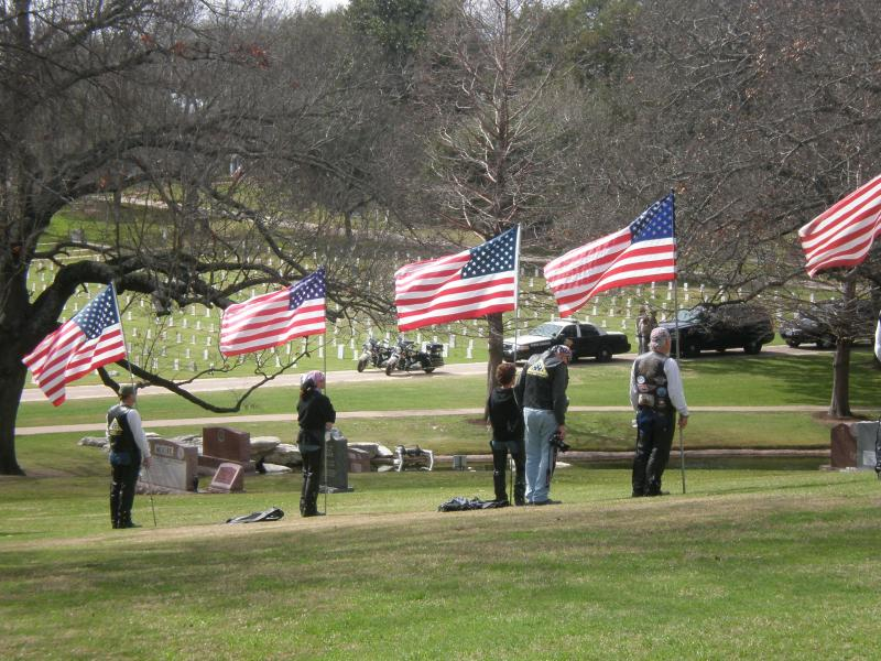 Patriot Guard riders fly flags during Chris Kyle's funeral.
