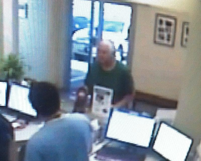 A security camera image shows the man who delivered a sick bat to Austin Vet Care.