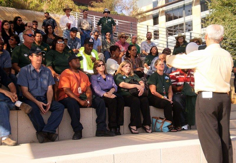 City workers rally at City Hall  in 2011. Most city employees have greater labor protections under Prop 10 passed in November.