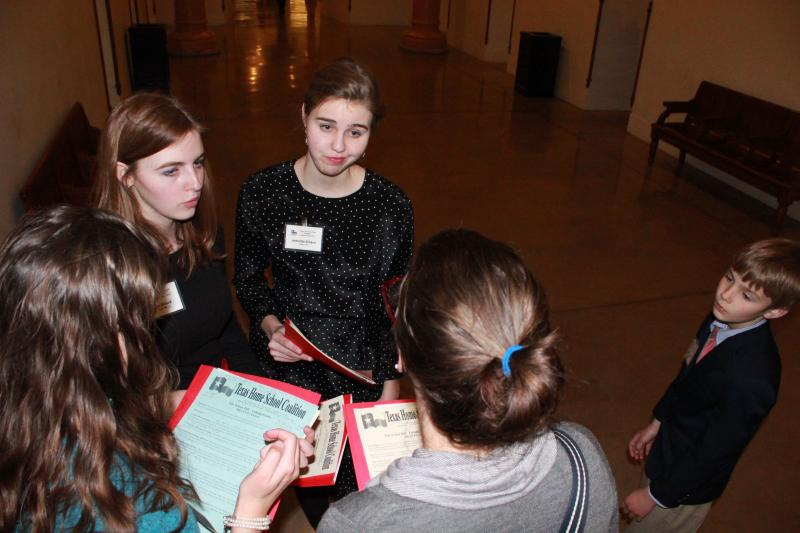 Sisters Jennet, Katy and Elizabeth Dillard went over strategy before heading off to visit lawmaker offices.