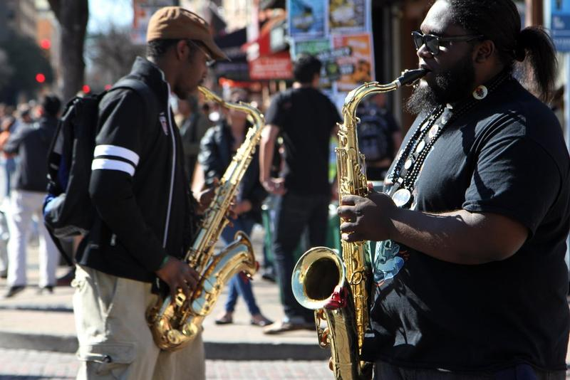 A duo of jazz musicians play on Sixth Street during SXSW.