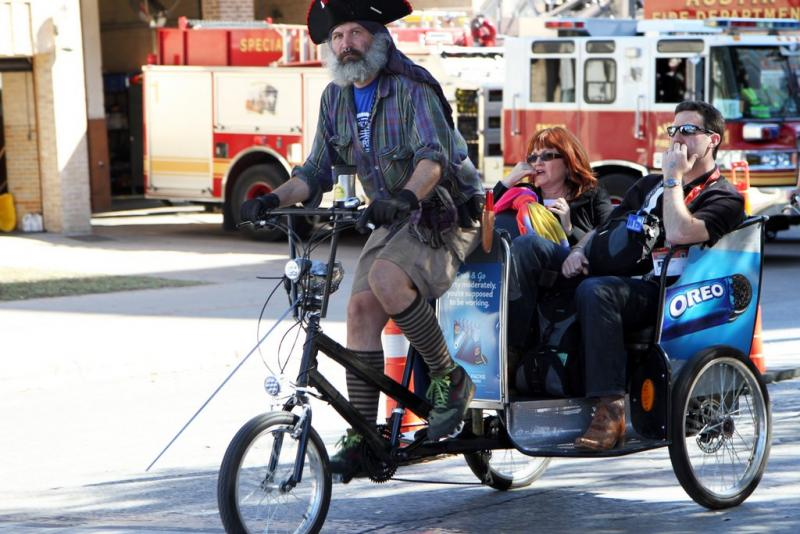 A pedicabber moves SXSW Interactive passengers with his Oreo-branded cab.